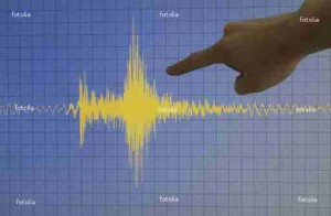 Hand pointing a yellow earthquake with a blue background